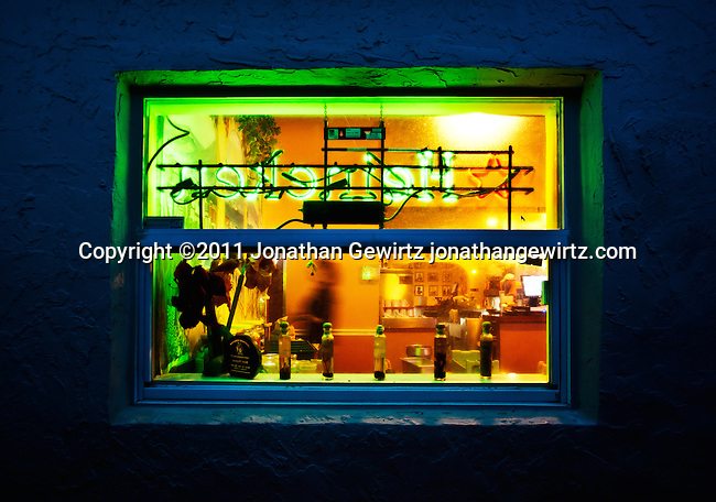 A colorful view into a restaurant at night.