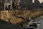 ©2008 David Burnett / Contact Press Images..July 10 2008..Havana, Cuba.A walk through the old city: .The Malecon at sunset