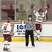 Melissa Bizzari (BC - 4) and Kelli Stack (BC - 16) celebrate Stack's third goal being indicated by Julie Piacentini. - The Boston College Eagles defeated the visiting Harvard University Crimson 6-2 on Sunday, December 5, 2010, at Conte Forum in Chestnut Hill, Massachusetts.