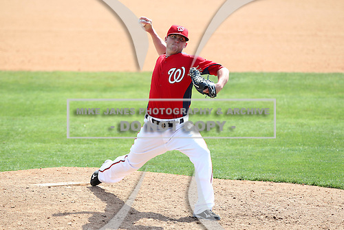 Washington Nationals Drew Storen #22 delivers a pitch during a spring training game against the Florida Marlins at Spacecoast Stadium on March 27, 2011 in Melbourne, Florida.  Photo By Mike Janes/Four Seam Images