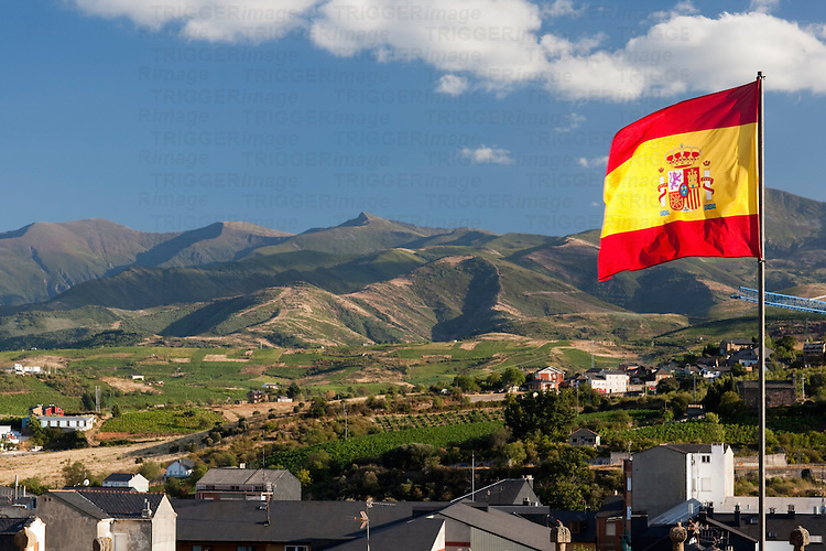 The flag of Spain waving on the top of the Templar castle, town of Ponferrada, El Bierzo region, province of Leon, autonomous community of Castilla and Leon, northern Spain