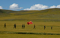 Chinese Soldiers with Chinese Flag in Tibet&rsquo;s province of Nakchu in Tibet hosts many festivals throughout the year, but one stands out more than any other; it is the highest horse racing festival in the world &ndash; a spectacle of colour, festivities and endurance for participants and visitors alike.<br />