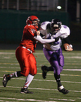 The Dallas Diamonds' Jessica Springer (right) holds off the Houston Energy's Renee Cosby during the Women's Professional Football League championship game. Springer is both a fullback and a linebacker.<br />