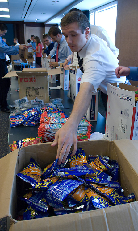 Staffers from senator Luger and Bayh's office help to assemble 400 gift packages for the Indiana National Guard members serving in Iraq and Afghanistan. The event was held at the Home Depot Washington Office at 101 Constitution Ave. in Washington, D.C.