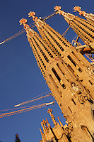 Two bell towers, Nativity Façade; Apse exterior?s pinnacles; Passion façade?s bell towers, completed late 1980?s by the sculptor Josep Maria Subirachs, La Sagrada Familia, Barcelona, Catalonia, Spain, Roman Catholic basilica, built by Antoni Gaudí (Reus 1852 ? Barcelona 1926) from 1883 to his death. Still incomplete. Picture by Manuel Cohen