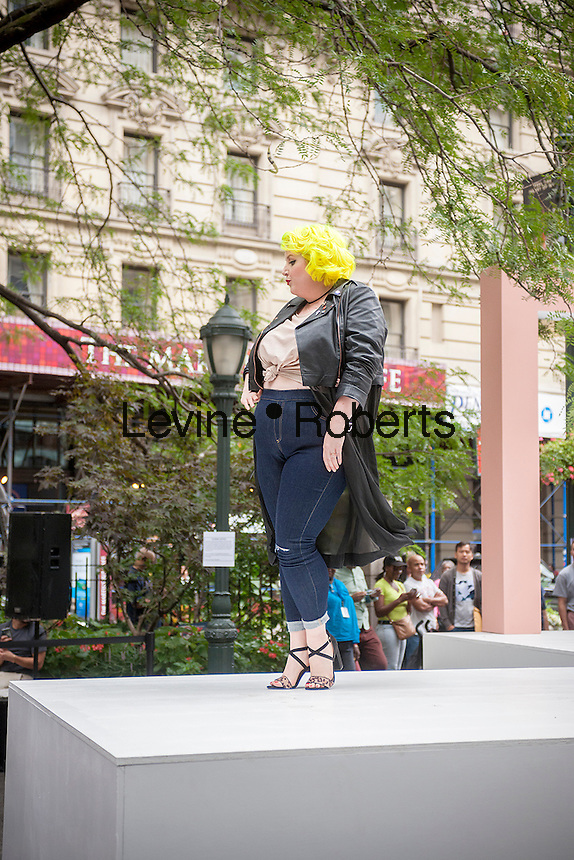"""JCPenney presents a fashion show of clothing for plus sized women created by designer Ashley Nell Tipton in Greeley Square in New York on Tuesday, September 6, 2016. Tipton is partnering with the department store in a plus-sized line for JCPenney's """"Boutique+"""" brand. Tipton was the winner of season 14 of Project Runway. (© Richard B. Levine)"""