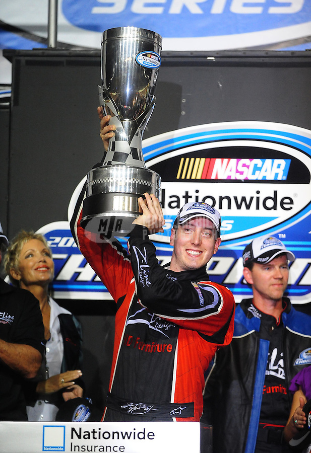Nov. 21, 2009; Homestead, FL, USA; NASCAR Nationwide Series driver Kyle Busch celebrates after winning the 2009 championship and the Ford 300 at Homestead Miami Speedway. Mandatory Credit: Mark J. Rebilas-