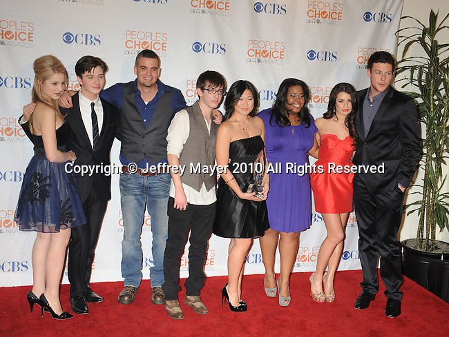 LOS ANGELES, CA. - January 06: Dianna Agron, Chris Colfer, Mark Salling, Kevin McHale, Jenna Ushkowitz, Amber Riley, Lea Michele and Cory Monteith pose in the press room at the People's Choice Awards 2010 held at Nokia Theatre L.A. Live on January 6, 2010 in Los Angeles, California.