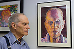 Port Washington, New York, U.S 6th October 2013. MAURICE NEWSTEIN, of Syosset, standing next to his self-portrait, a watercolor, at The Artists Reception for Members Showcase of The Art Guild of Port Washington, at The Graphic Eye Gallery.