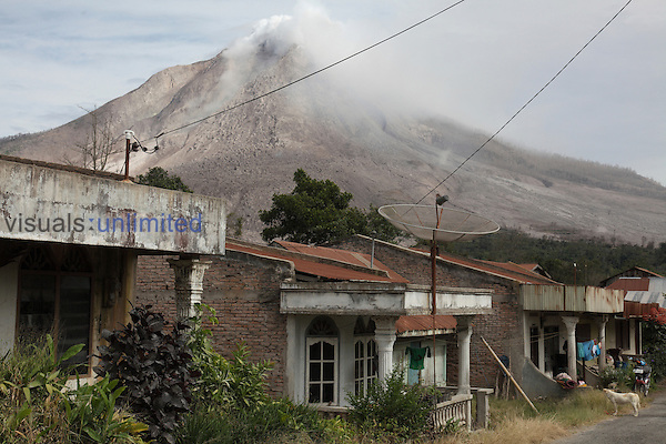 Evacuated village with Sinabung Volcano looming behind, Sumatra, Indonesia