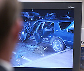 Prosecutors look at a photo of the car used by sniper suspect John Allen Muhammad as it is displayed on a screen in courtroom 10 at the Virginia Beach Circuit Court in Virginia Beach, Virginia on November 3, 2003.<br /> Credit: Lawrence Jackson - Pool via CNP