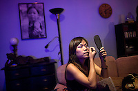 Kimmy one of the 'Me N Ma Girls', Myanmar's first girl band, applies makeup after a rehearsal before going to her evening job as a bar singer. The band's members were recruited by Australian dancer Nicole May. They sing and dance in the manner of many Western pop acts but in socially conservative Myanmar, they represent a radical break from the norm.