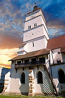 The medieval fortified church of Harman. A Romaneque church started in 1240 by the Cistercian monks with a 14th centurt bell tower & steps leading to storage rooms above the naive. Harman, Braşov, Transylvania. UNESCO World Heritage Site.