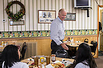 Vice President Joe Biden greets patrons during an unannounced stop at the Good Earth Restaurant during a two-day campaign swing through Iowa on Monday, September 17, 2012 in Muscatine, IA.