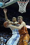 18 December 2013: Texas' Connor Lammert (right) and North Carolina's Brice Johnson (left) challenge for a rebound. The University of North Carolina Tar Heels played the University of Texas Longhorns at the Dean E. Smith Center in Chapel Hill, North Carolina in a 2013-14 NCAA Division I Men's Basketball game. Texas won the game 86-83.