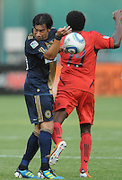 Philadelphia Union forward Carlos Ruiz (20) goes against DC United defender Clyde Simms (19) Philadelphia Union tied DC United 2-2, at RFK Stadium, Saturday July 2, 2011.