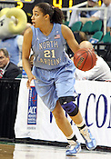 UNC guard Krista Gross looks for an open teammate in the first half. This was the Championship game of the 2011 ACC Tournament in Greensboro on March 6, 2011. Duke beat UNC 81-66. (Photo by Al Drago)