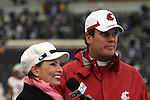 Washington State head football coach, Paul Wulff, is interviewed by Jen Mueller of Fox Sports Northwest, prior to the Cougars 2009 Apple Cup football game against arch-rival Washington at Husky Stadium in Seattle, Washington, on November 28, 2009.