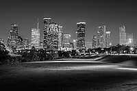 Houston skyline in black and white at night in the park in downtown that runs along the bayou. When they turn the lights on in the park we thought it would ruin our image but instead it made it look even better in our opinion.