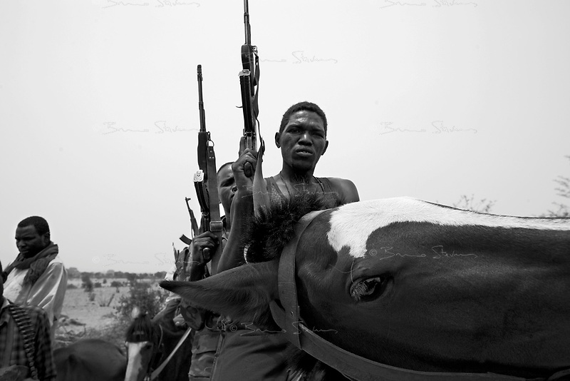 Andjadja, Eastern Tchad, June 3, 2004.Villagers have organized themselves into an militia to defend their land and villages against Djanjavid incursions.The large 'wadi' in the backgroung marks the border with Sudan.