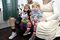 Chechen man with his wife and  2 children, in URiC Bielany refugee centre, Poland..He has lost his two legs during the Russian air bombing of AP over his village where were not any rebel fighters....During the hospitalisation in Ingushetia he has fallen in love with the doctor, theyve married soon and were trying hard to live a normal life with the daughter of 3 years and the son of 2 years. The Russian force were coming to his place weekly interrogating  and threatening . They have decided to leave for a safer place. Poland welcomed them..-For security reason, the face of the adult asylum seeker have been evicted of the photography..-For security reason, the names of the adult asylum seeker have been change. .-Article 9 of the Act of 13 June 2003 on grating protection on the Polish territory (Journal of Laws, No 128, it. 1176) personal data of refugees are an object of particular protection..-Cases where publication of a picture or name of asylum seeker had dramatic consequences for this persons and is family back in Chechnya. .Please have safety of those people in mind. Thank you.