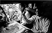 United States President Gerald R. Ford and Mexican President Luis Echeverra return the greetings of the Magdalena, Mexico crowd from Echeverra's Presidential autobus &quot;Miguel Hidalgo&quot; on October 21, 1974.  The brief visit to Mexico was the first foreign trip of the Ford Administration.  On the table before the two leaders is a Mexican newspaper headlining the meeting of the two presidents.<br /> Mandatory Credit: David Hume Kennerly / White House via CNP