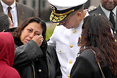 Washington, DC - September 11, 2009 -- The passage of eight years cannot diminish the terrible memories of September 11, 2001,  Chairman of the Joint Chiefs of Staff Adm. Mike Mullen, comforts a family member at the Pentagon Memorial, September 11, 2009. .Mandatory Credit: Robert D. Ward - DoD via CNP