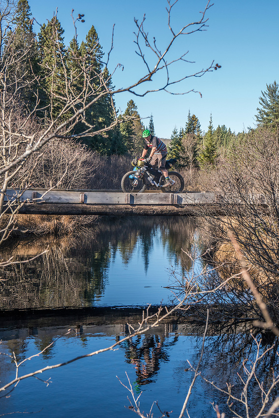 Crossing Mulligan Creek while  bikepacking in Marquette County, Michigan.