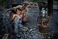 Coal miners in Zonguldok, Turkey, are close friends and share a joke.  This is the only place left in Turkey where mining is still done with hand tools and hand labor.<br /> Turkey's Black Sea coast has the highest peaks close to a sea anywhere in the world. The migration from summer fishing to highland shepherding has always been a part of the culture.  Mountain homes are called Yaylas (YIY-luz), and most families have more than one.  Families fish at the coast, but as the temperatures rise, they move to a succession of homes higher in the mountain range.  These homes are community property and were bequeathed during the Ottoman period.