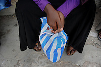 The girls carry their basketball boots in plastic bags inorder for the Al- shaabaab not to see that they are doing sports....Death or Play. Women&acute;s Basketball in Mogadishu.Women's basketball? In Europa and the U.S., we take it for granted. But consider this: In Mogadishu, war-torn capital of Somalia, young women risk their lives every time they show up to play..Suweys, the captain of the Somali women&acute;s basketball team, and her friends play the sport of the deadly enemy, called America. This is why they are on the hit list of the killer commandos of Al Shabaab, a militant islamist group, that has recently formed an alliance with the terrorist group Al Qaeda and control large swathes of Somalia...Al Shabaab, who sets bombs under market stands, blows up cinemas, and stones women, has declared the female basketball players ?un-islamic?. One of the proposed punishments is to saw off their right hands and left feet. Or simply: shoot them...Suweys&acute; team trains behind bullet-ridden walls, in the ruins of the failed city of Mogadishu - protected by heavily armed gun-men. The women live in constant fear of the islamist killer commandos. Stop playing basketball? Never, they say..Women&acute;s basketball in the world&acute;s most dangerous capital..