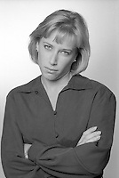 B&W Photo of a woman with a ruthless scowl.