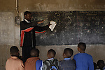 Zimbabwe, Robert's Range. May 2010. Maori Primary School, 281 pupils, 8 teachers, grades 1 to 7 plus Early Childhood Developement. No desks, chairs, toilets. Well the toilets are two holes and some distance away. The Howard gives educational support in the form of paying school fees and other. Grade Five, HUMANKWA Kane, teacher...