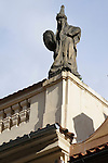 A statue on top of a building in Prague, Czech Republic.