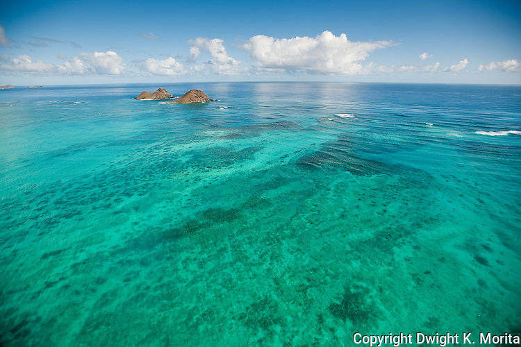 The shallow waters surrounding the Mokulua Islands in Lanikai radiate a range of beautiful colors in the afternoon light.