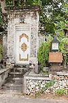 Sanur Beach, Bali, Indonesia; the ornate entrance door to the Villa Cinta from the boardwalk along the beach