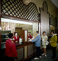 Tourist checking in at the Desert Inn, Daytona Beach Florida.