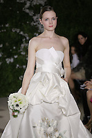 Model walks runway in an Angelika wedding dresses by Carolina Herrera, for the Carolina Herrera Bridal Spring 2012 runway show.