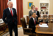 United States President Barack Obama signs the Ultralight Aircraft Smuggling Prevention Act of 2012 as former U.S. Representative Gabrielle Giffords (Democrat of Arizona), her husband Mark Kelly, right, and Joseph Biden, left, U.S. vice president, watch in the Oval office of the White House in Washington, DC, on February 10, 2012. The bill is the last piece of legislation that former Representative Gabrielle Giffords sponsored and voted on in the U.S. House of Representatives.   .Credit: Joshua Roberts / Pool via CNP