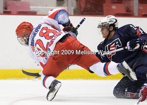 Alexander Burmistrov (Russia - 28), Zach Budish (US - 24) - Team Russia defeated Team USA 6-4 in their third game in the 1980/Herb Brooks (international-size) Rink on Friday, August 14, 2009, during the 2009 USA Hockey National Junior Evaluation Camp in Lake Placid, New York.