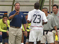 Head Coach Bruce Arena gives instructions to defender Eddie Pope. The USA tied South Korea, 1-1, during the FIFA World Cup 2002 in Daegu, Korea.