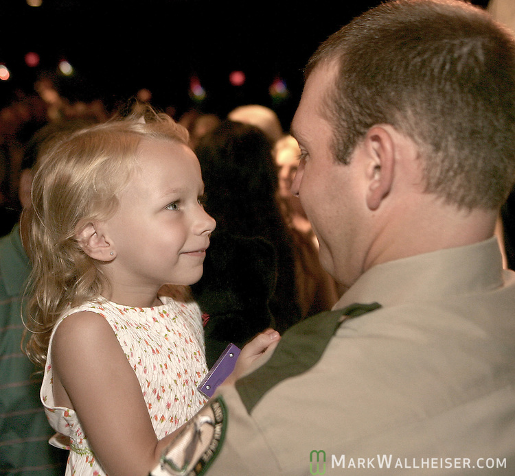 New graduate Robert Burris, right, gets an admiring smile and hug from his neice Lauren Van Rysoylk, 4 years-old, after graduation ceremonies for 34 new Florida Fish and Wildlife Conservation Commission law enforcement officers in Turner Auditorium at Tallahassee Community College August 16, 2007.  (Mark Wallheiser/TallahasseeStock.com)