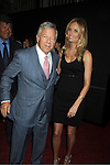 "Robert Kraft and girlfriend attend the World Premiere of ""The Bourne Legacy"" on July 30, 2012 at The Ziegfeld Theatre in New York City. The movie stars Jeremy Renner, Rachel Weisz, Edward Norton, Stacy Keach, Dennis Boutsikaris and Oscar Isaac."
