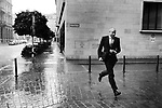 Banker on the run from the rain, by the head quarters of UBS.