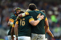 Adriaan Strauss of South Africa embraces team-mate Lodewyk De Jager after scoring a try. Rugby World Cup Pool B match between South Africa and Japan on September 19, 2015 at the Brighton Community Stadium in Brighton, England. Photo by: Patrick Khachfe / Onside Images
