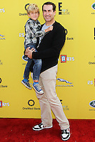 SANTA MONICA, CA, USA - NOVEMBER 16: George Riggle, Rob Riggle arrives at the P.S. ARTS Express Yourself 2014 held at The Barker Hanger on November 16, 2014 in Santa Monica, California, United States. (Photo by Celebrity Monitor)