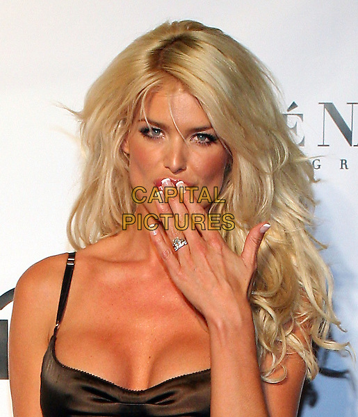 VICTORIA SILVSTEDT.At Fashion Rocks held at Radio City Music Hall,.New Tork, 8th September 2005.portrait headshot brown satin strappy dress cleavage fingers hand mouth engagement ring wedding.Ref: ADM/JL.www.capitalpictures.com.sales@capitalpictures.com.© Capital Pictures.