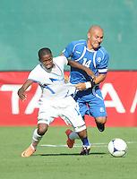 Honduras midfielder Oscar Garcia (14) gets fouled by El Salvador midfielder Dennis Alas (14) Honduras National Team defeated El Salvador 3-0 at RFK stadium, Saturday June 2, 2012.