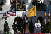 U.S. President Barack Obama (L) delivers remarks during an arrival ceremony with Pope Francis (R)  at the White House on September 23, 2015 in Washington, DC. The Pope begins his first trip to the United States at the White House followed by a visit to St. Matthew's Cathedral, and will then hold a Mass on the grounds of the Basilica of the National Shrine of the Immaculate Conception.  <br /> Credit: Win McNamee / Pool via CNP