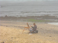 Plein air artist Edwin Bertolet (www.ebertolet.com)  at his easel, surrounded by the mist and fog of California's coast.