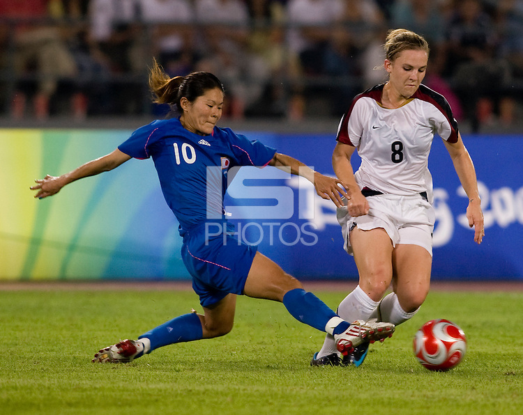 USWNT forward (8) Amy Rodriguez sprints past Japanese captain (10) Homare Sawa while playing at Worker's Stadium.  The USWNT defeated Japan, 4-2, during the semi-finals of the Beijing 2008 Olympics in Beijing, China.